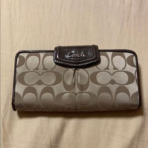 Coach wallet with snap closure
